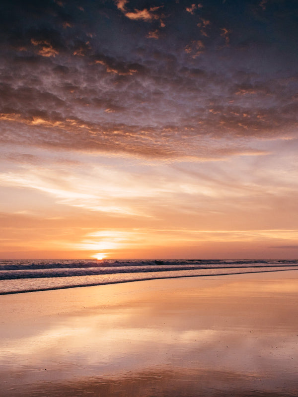 Beautiful sunset in Playa Langosta Costa Rica. Photographed by Samba to the Sea for The Sunset Shop.