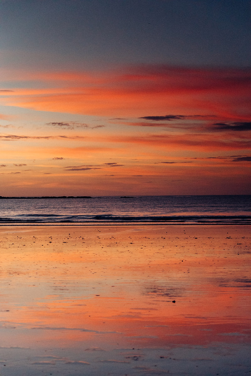 Sunset reflections in Tamarindo Costa Rica. Sunset art pictures photographed by Kristen M. Brown, Samba to the Sea for The Sunset Shop.