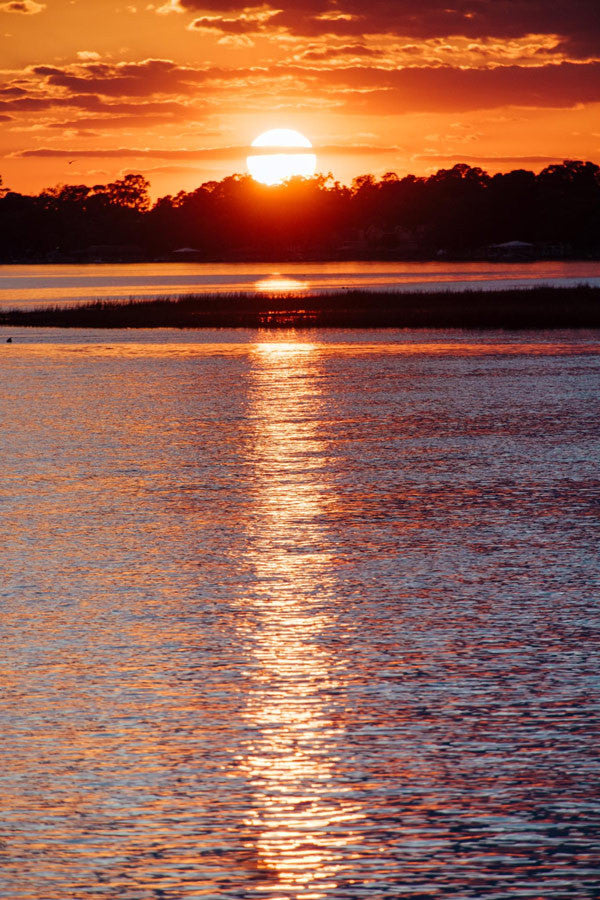 Sunset over Moon River in Savannah, Georgia. Photographed by Kristen M. Brown, Samba to the Sea at The Sunset Shop.