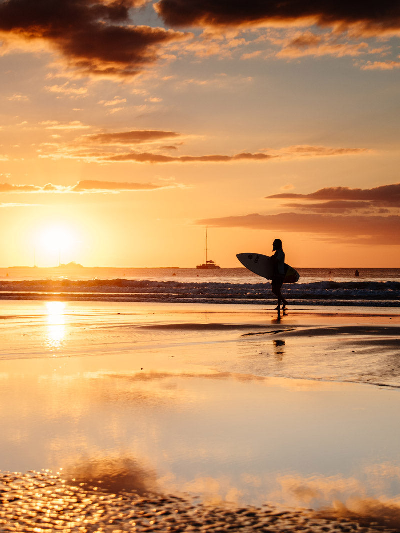 Surfer during sunset in Tamarindo Costa Rica. Photographed by Kristen M. Brown, Samba to the Sea for The Sunset Shop.