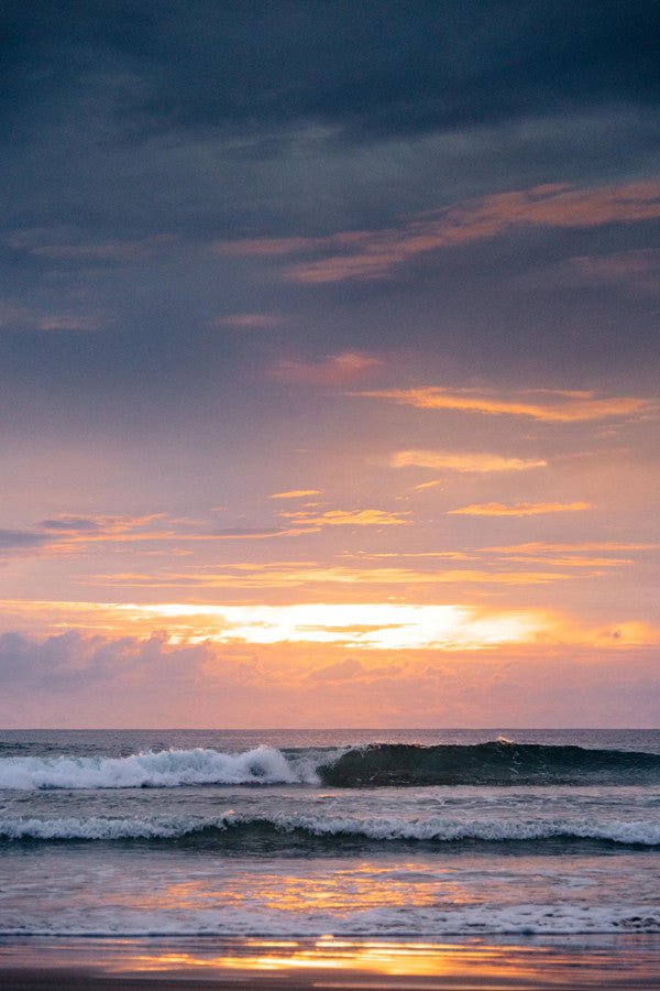 Peeling wave at sunset in Tamarindo Costa Rica. Photographed by Kristen M. Brown, Samba to the Sea.