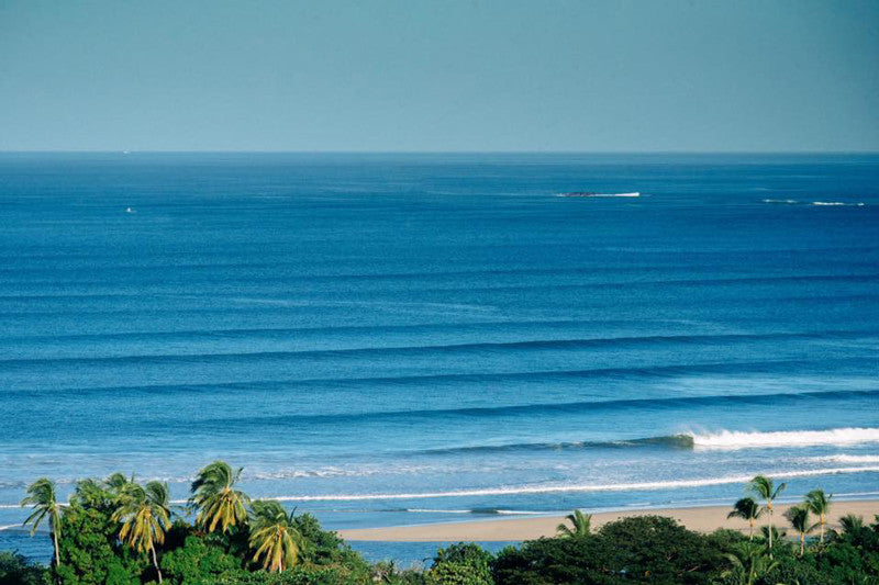 Breaking right wave in Tamarindo Costa Rica. Corduroy lines in Costa Rica. Photographed by Kristen M. Brown, Samba to the Sea.