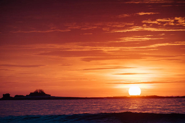 Gorgeous sun passing over the horizon in Tamarindo, Costa Rica.  Photographed by Kristen M. Brown, Samba to the Sea at The Sunset Shop.