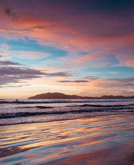 Beautiful pink sunset in Tamarindo Costa Rica. Photographed by Samba to the Sea for The Sunset Shop.