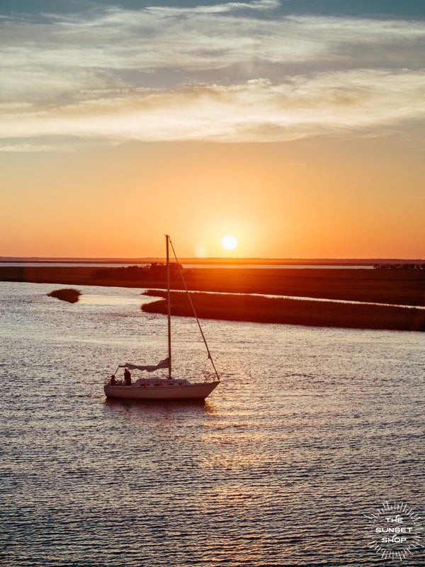 There's nothing quite like being the captain of your own vessel, harnessing the power of the wind, gliding across the water, and going whichever course your heart desires. Especially after a glorious day sailing and coming in to dock during sunset over the marsh! Sunset over the marsh in Savannah, Georgia photographed by Kristen M. Brown of Samba to the Sea for The Sunset Shop.
