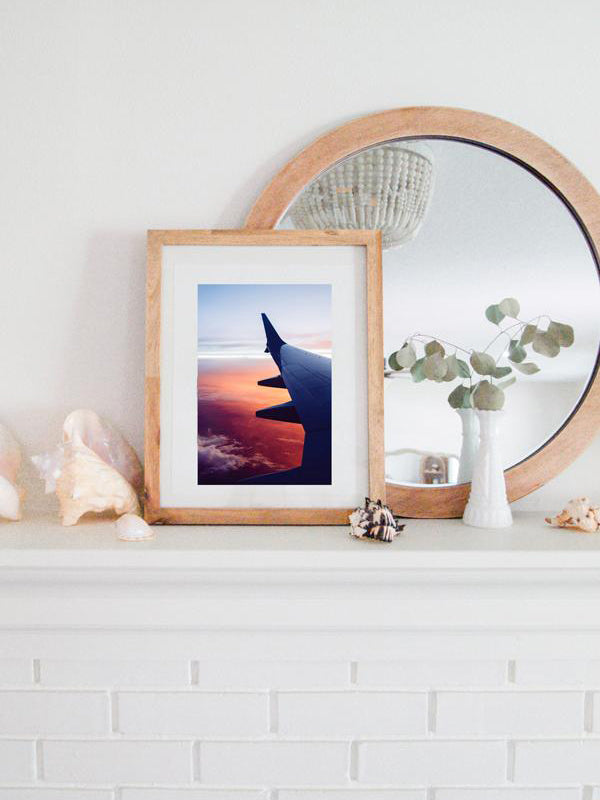 "Because life was meant for good friends and adventures. Be inspired to go on your next adventure with this magical pink sunset from an airplane print ""And So The Adventure Begins"". Photographed by Kristen M. Brown, Samba to the Sea."