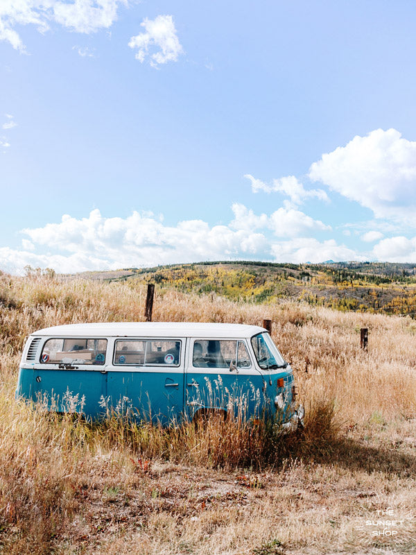 "Beautiful turquoise VW bus framed with shimmering golden Aspens in Colorado. ""Aspen Bus"" photographed by Kristen M. Brown, Samba to the Sea for The Sunset Shop."