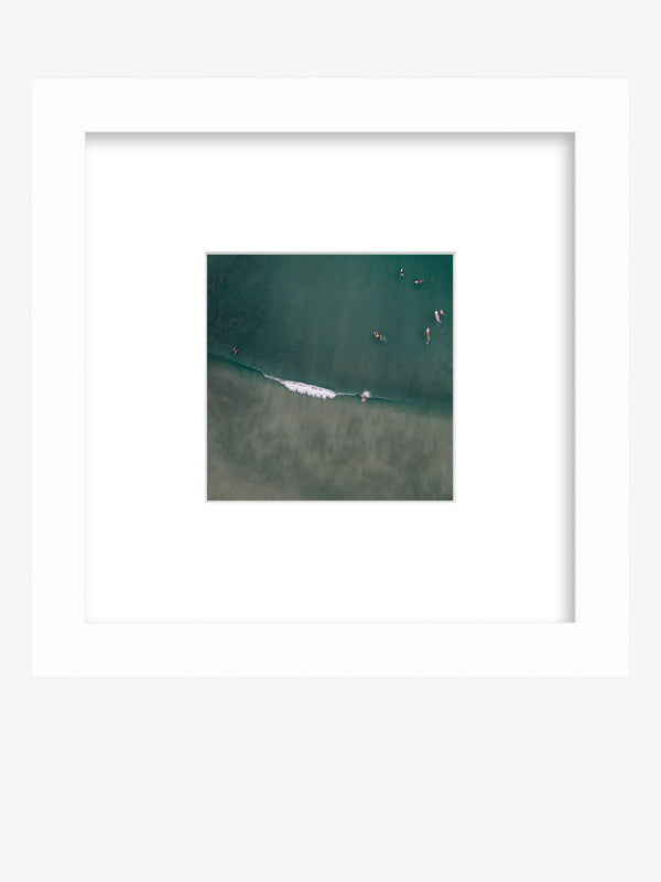 Aerial surfer wave print framed shelfie by Samba to the Sea at The Sunset Shop. Image is an aerial photo of surfer dropping in on a wave in Playa Avellanas, Costa Rica.