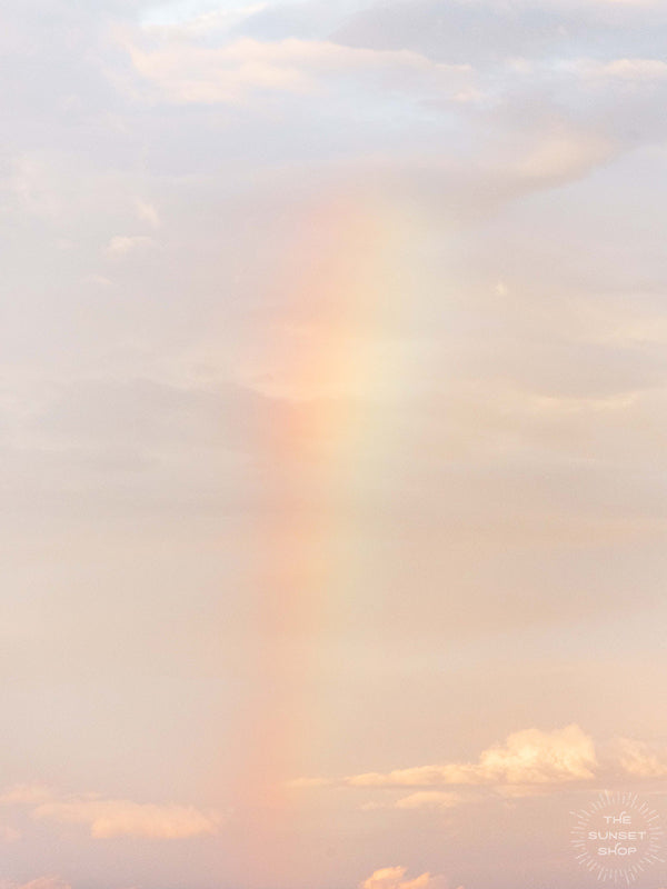 Little baby rainbow in a pastel sunset sky in Costa Rica. Photographed by Kristen M. Brown of Samba to the Sea for The Sunset Shop.