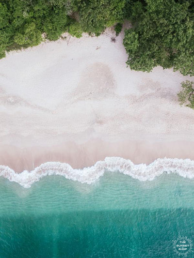 Aerial image of white sand beach and turquoise water of the beach at Playa Conchal, Costa Rica. Aerial beach print by Samba to the Sea at The Sunset Shop.