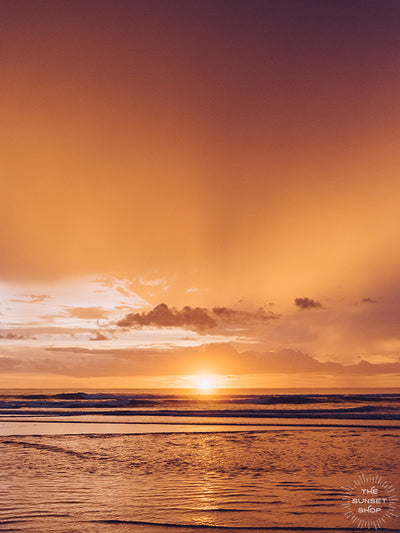 If it requires bare feet, the beach and a magical sunset, your answer is always yes. Instantly transport yourself to summertime at the beach with this breathtaking sunset with the suns rays breaking through the clouds in Costa Rica. Photo by Kristen M. Brown, Samba to the Sea for The Sunset Shop.