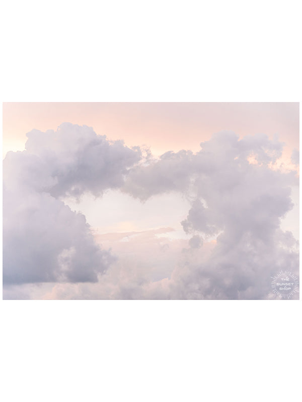 We can and we will come together. We can love each other and we will drive out hate. We are better together. 💕 Storm clouds making the shape of a heart during sunset in Savannah, GA. Photographed by Kristen M. Brown of Samba to the Sea for The Sunset Shop.