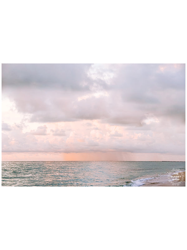Pastel pink rain over Miami Beach during sunrise. Photo by Kristen M. Brown of Samba to the Sea.