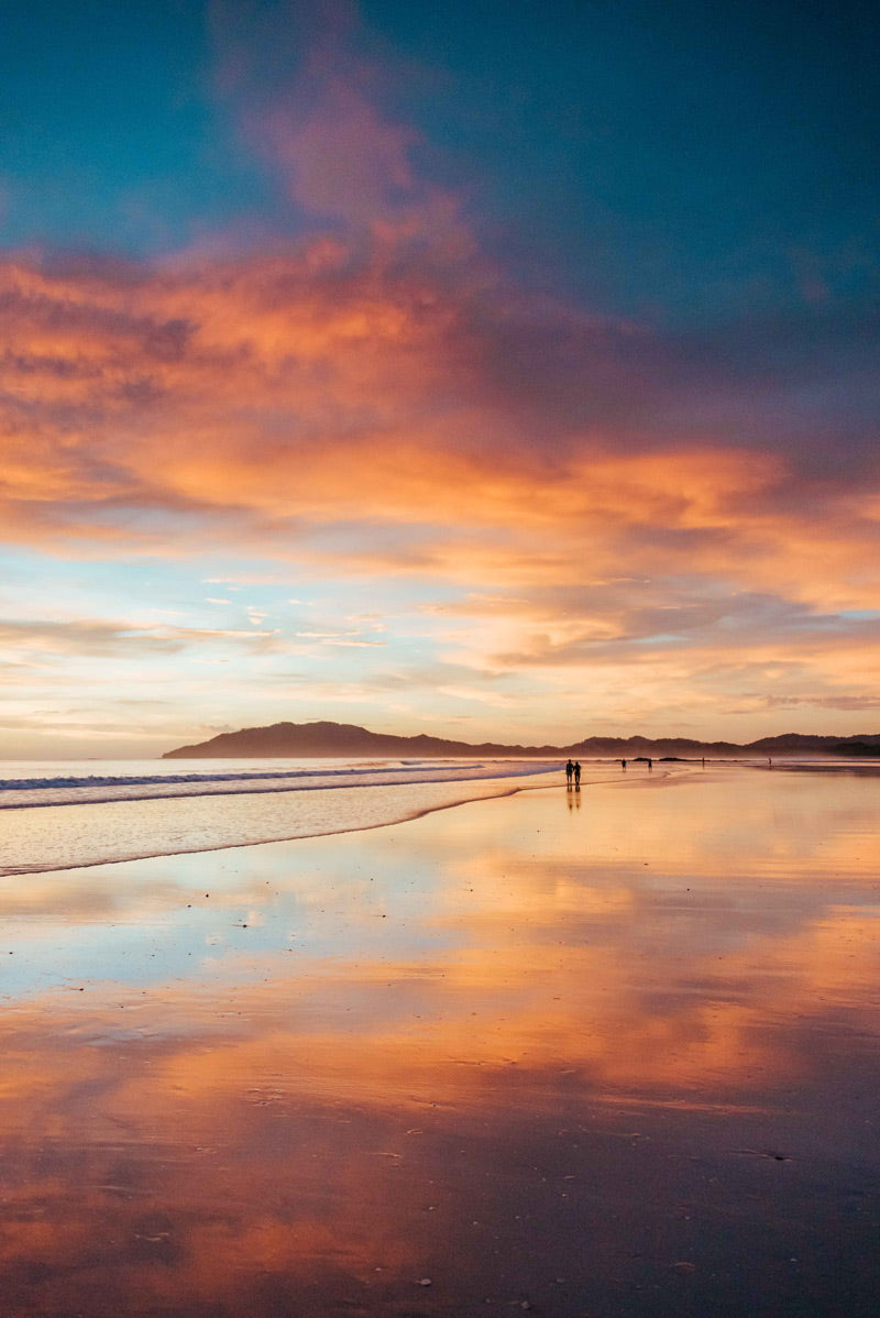 Magical golden orange beach sunset in Tamarindo Costa Rica.  Photographed by Kristen M. Brown, Samba to the Sea.