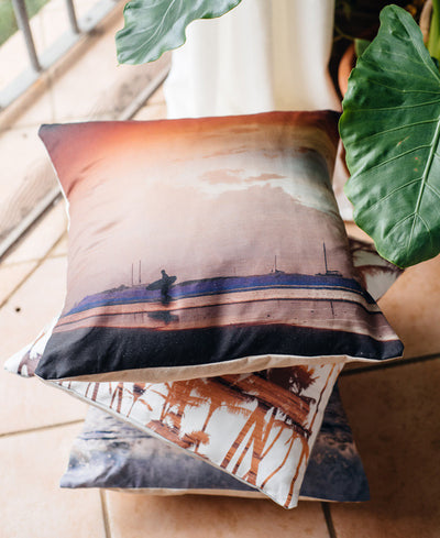 Dance to the Song of the Sea throw pillow by Samba to the Sea at The Sunset Shop. Surfer walking on the beach during a pastel pink sunset in Costa Rica.