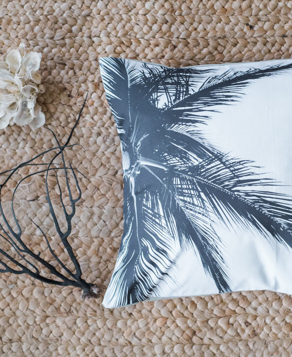 Black and white image of palm tree fronds accent pillow by Samba to the Sea.