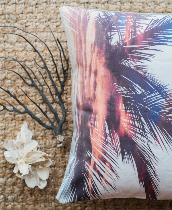 Palm tree fronds infused with a sunset, double exposure accent pillow. Tassel accent pillow by Samba to the Sea at The Sunset Shop.