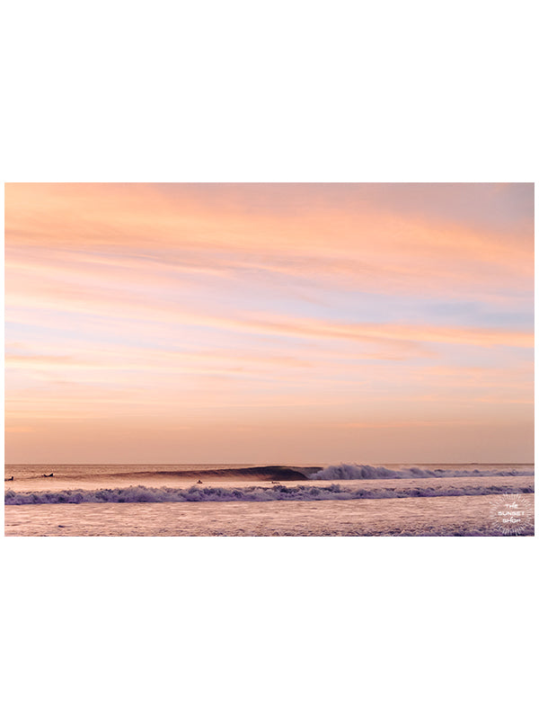 Rose gold sunset waves breaking in Costa Rica. Hola Ola! sunset wave print by Samba to the Sea at The Sunset Shop. Image of breaking waves during a beautiful sunset in Costa Rica.