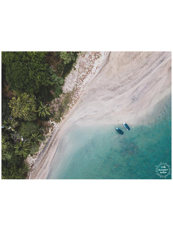 Tamarindo Costa Rica estuary. Aerial image of turquoise water, white sand beach, boats, and palm trees. Aerial beach print by Samba to the Sea at The Sunset Shop.