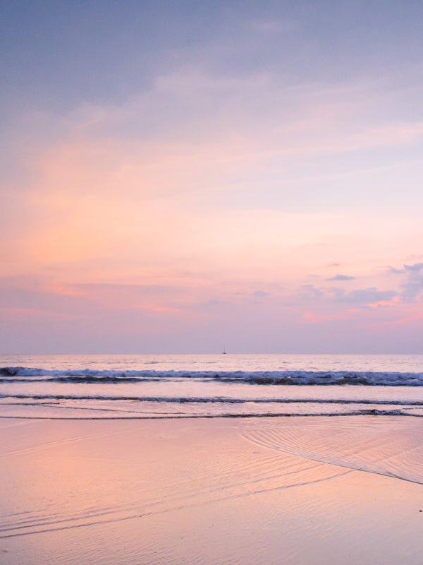 Beautiful pastel pink sunset in Tamarindo Costa Rica. Photographed by Samba to the Sea for The Sunset Shop.