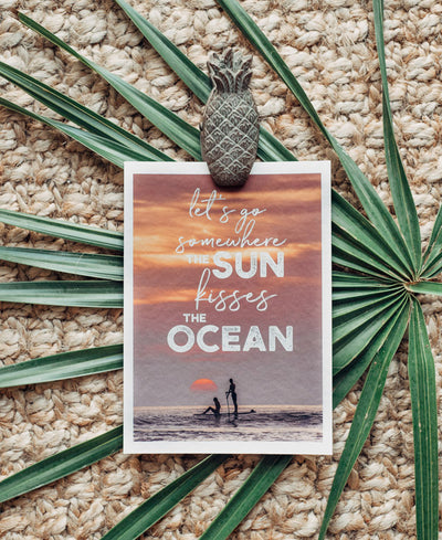 Let's go somewhere the sun kisses the ocean sunset wanderlust image by Samba to the Sea at The Sunset Shop.