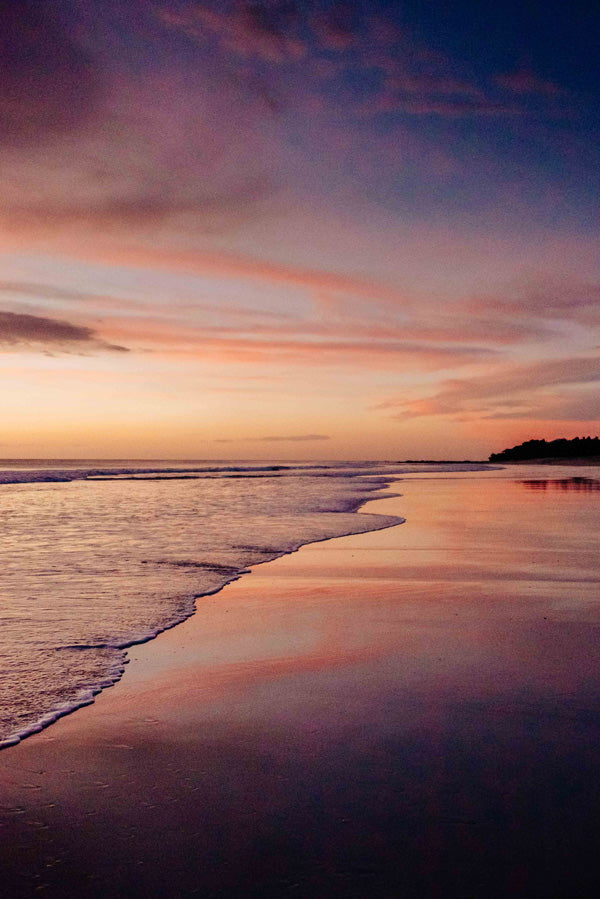 Beautiful painted sunset sky in Playa Langosta Costa Rica. Photographed by Samba to the Sea for The Sunset Shop.