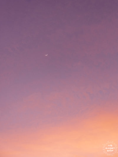 Crescent moon in a purple and rose gold pastel sunset sky in Tamarindo Costa Rica. Photo by Kristen M. Brown, Samba to the Sea at The Sunset Shop.