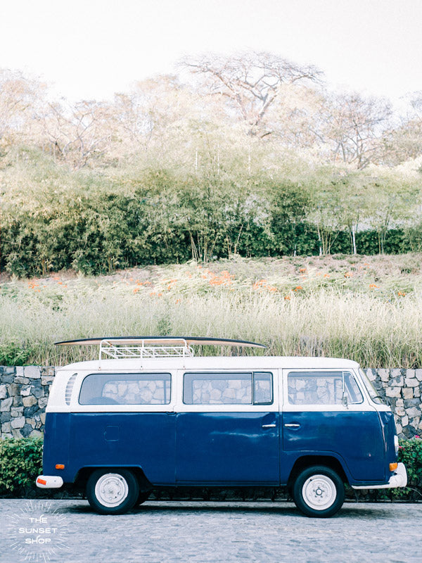 "Life is simple - - surf 🏄🏼‍♀️ , jam 🎸, live life in a VW Van 🚌 . Channel those carefree, summertime beach days at home with this indigo blue surfer VW bus print in Costa Rica. ""Magic Bus"" photographed by Kristen M. Brown, Samba to the Sea for The Sunset Shop."