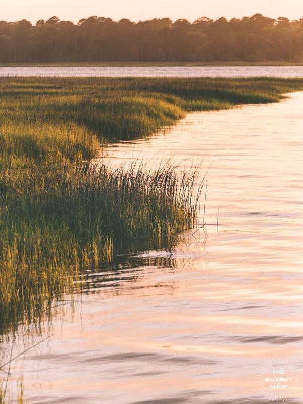 "Take a deep breath and say thank you to a beautiful day with a serene sunset sky over the marsh in Savannah, GA. ""Marsh en Rosé"" photographed by Kristen M. Brown, Samba to the Sea for The Sunset Shop."