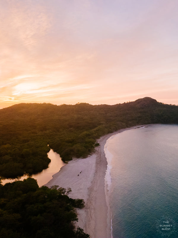 """New Year Magic"" aerial sunset print by Samba to the Sea at The Sunset Shop. Image is an aerial photo of sunset over the beach in Playa Conchal, Costa Rica."