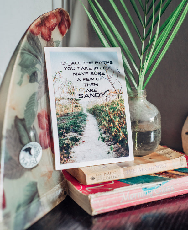Of all the paths you take in life make sure a few of them are sandy. Gone to the Beach wanderlust image by Samba to the Sea at The Sunset Shop.