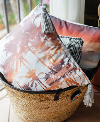 Palm trees infused with a sunset, double exposure tassel accent pillow. Accent pillow by Samba to the Sea at The Sunset Shop.