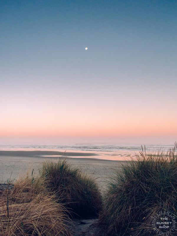 "Full moon setting during a pastel pink sunrise on the Oregon Coast. ""Pink Side of the Moon"" sunrise beach print by Kristen M. Brown, Samba to the Sea."