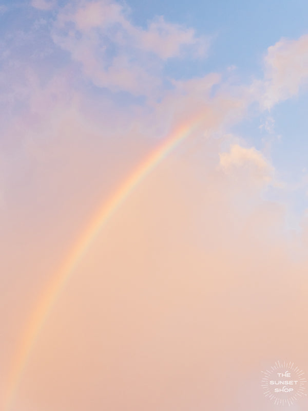 "Pastel sunrise sky and a rainbow in Miami, Florida. Just look up and you may find this is rainbow to heaven painting the sunrise sky. 🌅🌈 ""Rainbow to Heaven"" photographed by Kristen M. Brown, Samba to the Sea. Available at The Sunset Shop."
