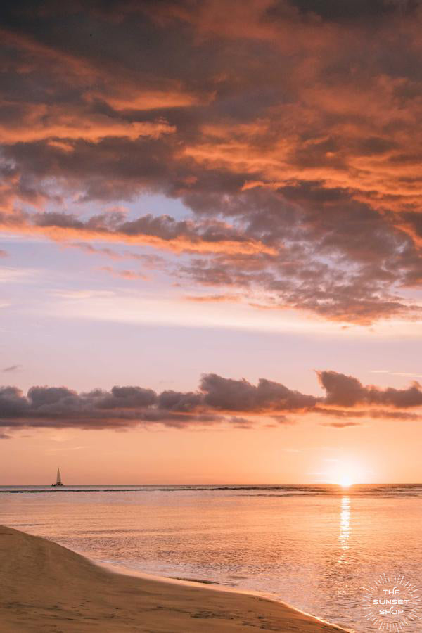 "Sunset sky in Costa Rica with sailboat sailing on the horizon. ""Rhiannon"" sunset print by Samba to the Sea at The Sunset Shop."