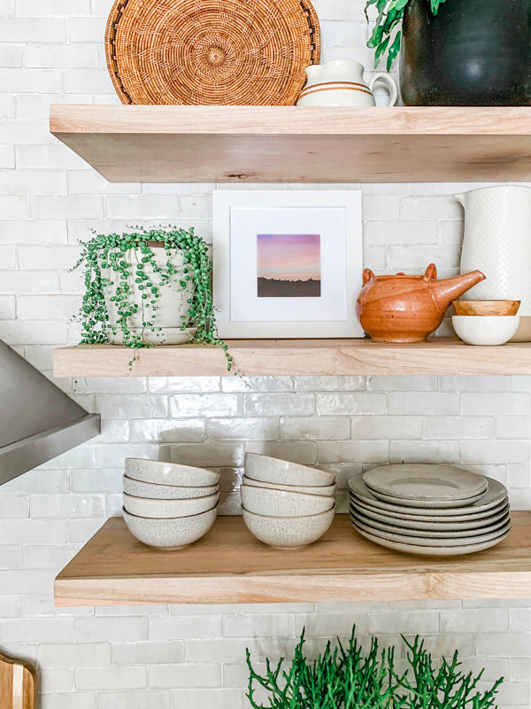 "Mountain sunset shelfie print on open shelving in a beautiful kitchen. Pastel pink sunset sky over the Columbia Rive Gorge in Oregon. Sunset sky over the mountain ridge in Oregon. ""Room At the Top"" pastel sunset print by Kristen M. Brown, Samba to the Sea. Style by Girl and Grey."