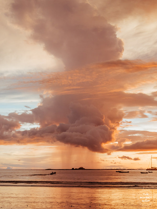 Rose Gold Rain sunset print by Samba to the Sea at The Sunset Shop. Image is a rain shower passing over the horizon during a rose gold sunset in Tamarindo, Costa Rica.