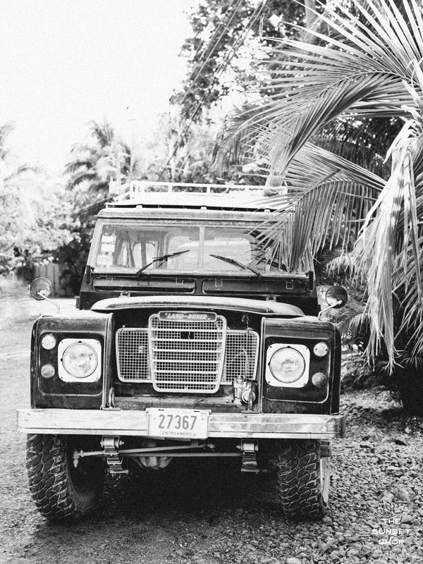 Because life is all about the magic in the detours and the beauty of taking time to explore bumpy, back road dirt roads in tropical paradise with a vintage Land Rover just like this. Black & White Vintage Land Rover Series 3 in Nosara, Costa Rica. Photographed by Kristen M. Brown, Samba to the Sea for The Sunset Shop.