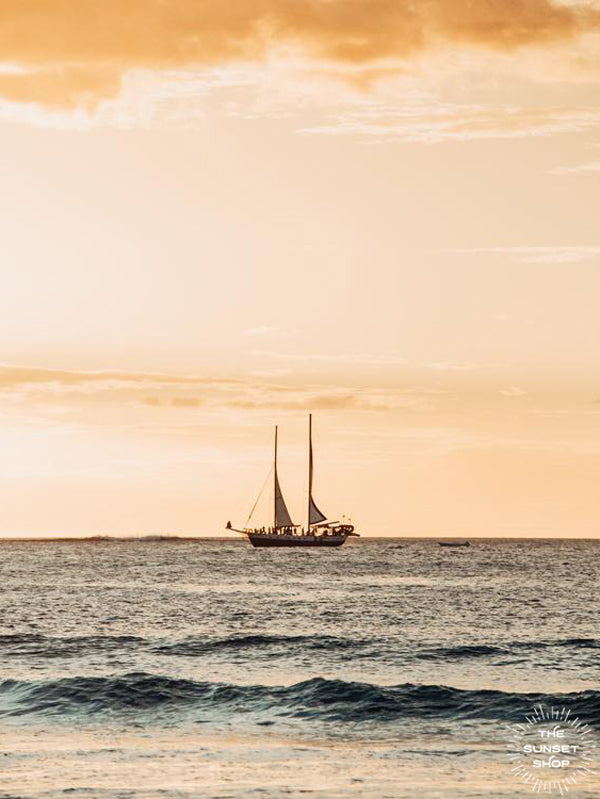 Golden sunset sail in Tamarindo Costa Rica. Photographed by Samba to the Sea for The Sunset Shop.