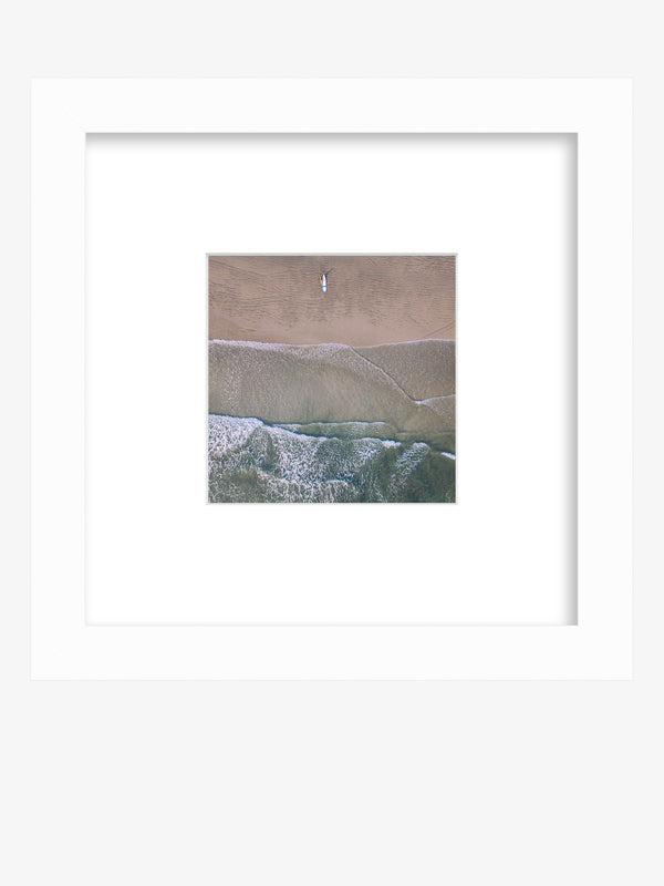Aerial image of surfer on the beach in Nosara Costa Rica. Salt & Water aerial framed shelfie beach print photographed by Samba to the Sea for The Sunset Shop.