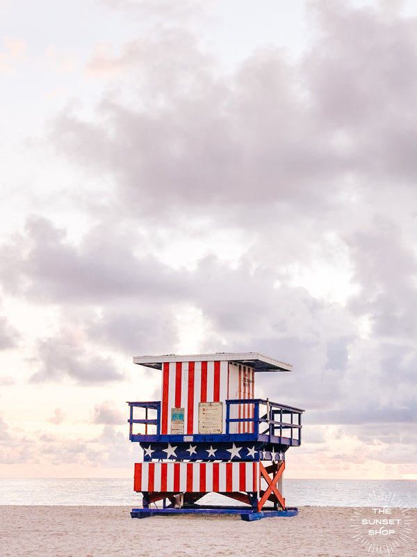 Pastel sunrise over South Beach in Miami with Stars and Stripes lifeguard tower. Photographed by Kristen M. Brown of Samba to the Sea for The Sunset Shop.