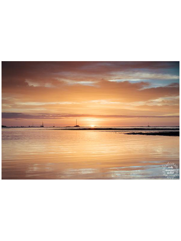 Summer of Love sunset print by Samba to the Sea at The Sunset Shop. Image is a golden sunset reflecting off the ocean in Tamarindo, Costa Rica.