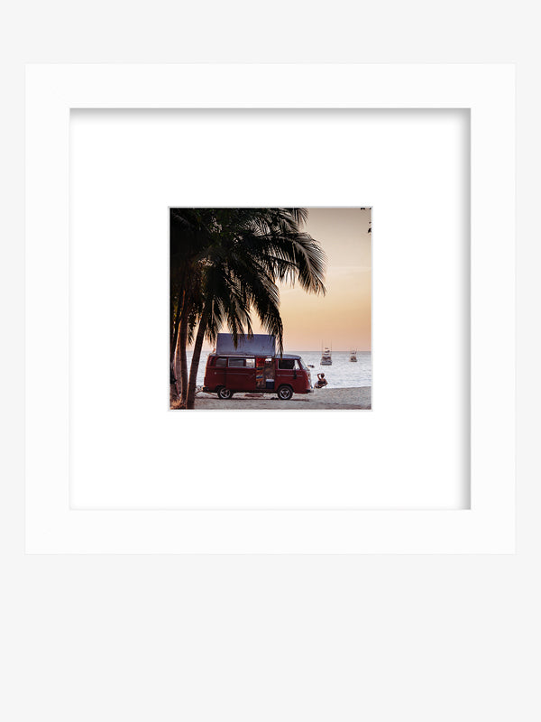 The Sunset Bus framed shelfie print by Samba to the Sea at The Sunset Shop. Photograph of a VW Bus on the beach in Tamarindo, Costa Rica during sunset.