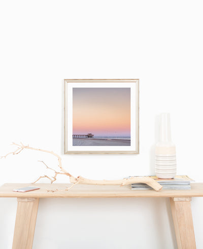 Sunset beach fine art print. Beautiful pastel pink sunset of Tybee Island Pier in Tybee Island, Georgia. Photographed by Samba to the Sea for The Sunset Shop, framed by Framebridge.