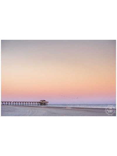 Beautiful pastel pink sunset of Tybee Island Pier in Tybee Island, Georgia. Photographed by Samba to the Sea for The Sunset Shop.
