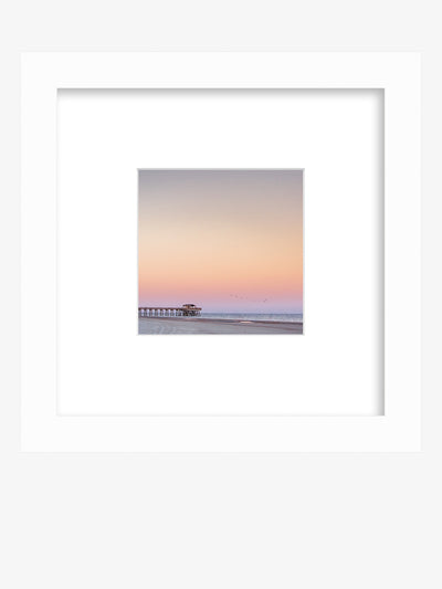 Pastel pink beach sunset framed shelfie print. Beautiful pastel pink sunset of Tybee Island Pier in Tybee Island, Georgia. Photographed by Samba to the Sea for The Sunset Shop.