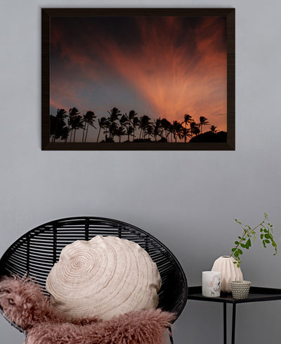 Palm trees silhouetted against a pink sunset cloud in Tamarindo, Costa Rica. That Summer Feeling print by Samba to the Sea at The Sunset Shop.
