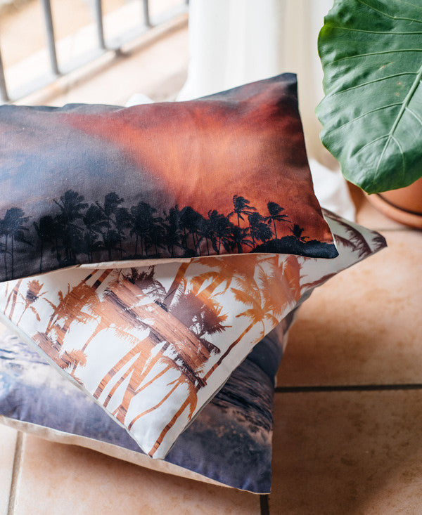 That Summer Feeling tassel throw pillow by Samba to the Sea at The Sunset Shop. Palm trees with pink sunset sky in Costa Rica.