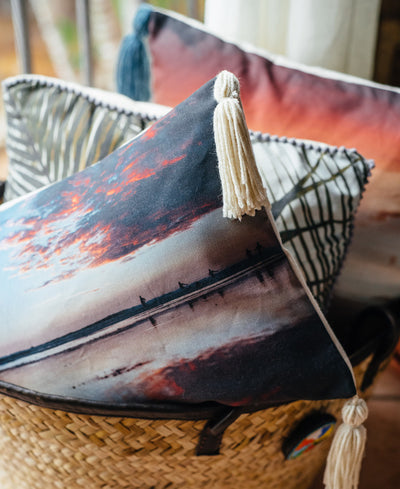 Vitamin Sea tassel throw pillow by Samba to the Sea at The Sunset Shop. Beachgoers enjoying the ocean during sunset in Costa Rica.