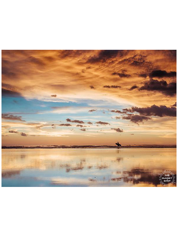 Surfer walking on the beach during a beautiful sunset in Costa Rica. Sunset surfer print by Samba to the Sea at The Sunset Shop.